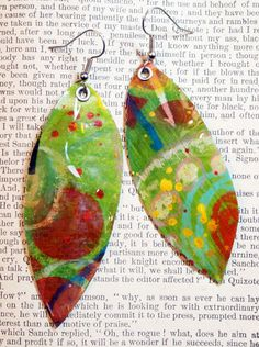I'm using deli paper, but you  can use anything, including fabric) and cover it with paint. Glue a page from a book on the back. dip in melted clear Ultra Thick Embossing Enamel (UTEE).  http://alisaburke.blogspot.com/2011/11/guest-post-paper-earrings-from-julie.html