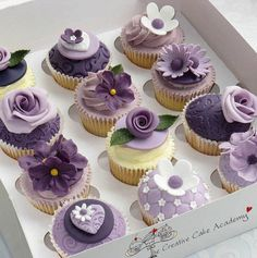 Purple wedding cupcakes. I LOVE the different flowers...should match my bouquet :D