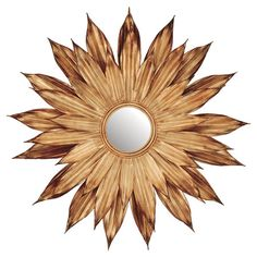 Perfect for anchoring a bold accent wall, this eye-catching wall mirror showcases a blooming flower design in gold.   Product: Wall ...