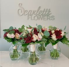 Burgandy and Blush Roses accented with Greenery. Designed by Scarlett's Flowers