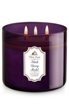 """Black Cherry Merlot - 3-Wick Candle - Bath & Body Works - The Perfect 3-Wick Candle! Made using the highest concentration of fragrance oils, an exclusive blend of vegetable wax and wicks that won't burn out, our candles melt consistently & evenly, radiating enough fragrance to fill an entire room. Candle comes in beautiful colored glass, topped with a flame-extinguishing lid! Burns approximately 25 - 45 hours and measures 4"""" wide x 3 1/2"""" tall."""