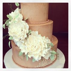 A different-from-usual wedding cake with chocolate buttercream on the outside. Delicious and pretty!! Photo by Sugar Flower Cake Shop. www.sugarflowercakeshop.com