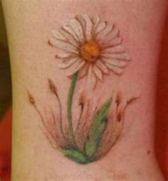 What does daisy tattoo mean? We have daisy tattoo ideas, designs, symbolism and we explain the meaning behind the tattoo. White Daisy Tattoo, Daisy Chain Tattoo, Daisy Flower Tattoos, Daisy Flowers, Daisies, Floral Tattoos, Feminine Tattoos, Birth Flowers, Mom Tattoos