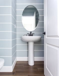 Powder Bathroom   Coastal Powder Theme   Blue and White Stripes   Seagrass Wreath   Designer: Juxtaposed Interiors   Painter: Stanger Projects