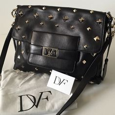DIANE VON FURSTENBERG BAG AND TABLET POCKET Black leather Diane von Furstenberg crossbody bag with silver-tone hardware, chain-link shoulder strap, stud details throughout, dual exterior pockets; one with zip closure, taupe woven interior lining, four pockets at interior walls; one with zip closure and magnetic closure at front flap. Very Good condition. Custom TABLET POCKET. Like New  Excellent condition Diane von Furstenberg Bags Crossbody Bags