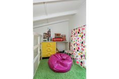 Cindy Brady would have *loved* this groovy little loft area, no? It's got the bean bag, the shag carpeting, the privacy ...