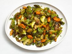 Roasted Brussels Sprouts and Carrots from FoodNetwork.com  i'm going to make this with rainbow carrots this year should be really pretty.