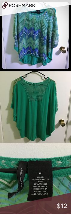"""New Directions flowy blouse Kelly green cosmic flowy blouse, high-low hemline, sheer front, pretty lace back detail. Front 19""""long, back 26"""" long. Great with white jeans. new directions Tops Tunics"""