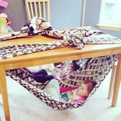 Chair for toddler. Super fun fort idea for kids. Under table swing for toddler. Reading nook for toddler. Cute, easy and free! Simply secure a blanket to your dining table and climb in! Indoor Activities, Toddler Activities, Diy For Kids, Cool Kids, Kids Crafts, Toddler Fun, Toddler Toys, Diy Toys, Kids And Parenting