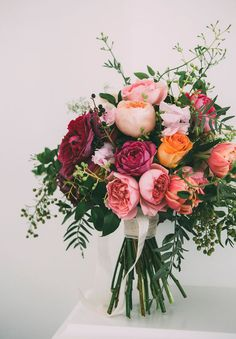 Colorful Rose Bouquet: Roses never go out of style in the wedding world, which is great news for fall brides. These gorgeous blooms are plentiful and readily available in the autumn months, and available in nearly every color you could imagine.