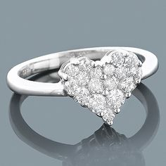 This Ladies 14K Gold Designer Diamond Heart Ring from our diamond heart jewelry collection showcases 0.68 ctw of sparkling round diamonds, each masterfully set in luscious 14K gold. Featuring an elegant design and a highly polished gold finish, this fabulous diamond heart ring makes a unique pre-set diamond engagement ring, and is available in 14K white, yellow and rose gold.