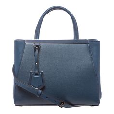 For a sleek burst of color, the 2Jours shopper bag from Fendi does it right. This blue leather bag combines a Saffiano front and back with Vitello leather side panels, finished with a logo-engraved framed top.