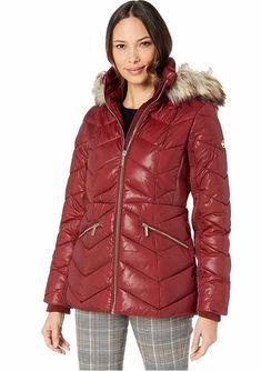 Michael Kors Burgundy Short Down Quilted Puffer Jacket With a Faux-Fur Trim Women's. Women's Quilted Burgundy Puffer Jacket With Faux Fur Trim Hood. Crafted from a quilted poly woven with ribbed internal cuffs at the long sleeves, zipper hand pockets. finish. #PufferCoats #WinterCoats #MichaelKors