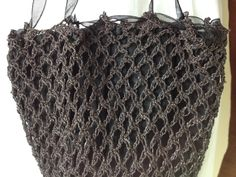 1800-1810 metallic black crocheted reticule. Lined with black silk faille.
