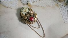 Vintage Style Collage Brooch with Maroon Accent by FromABygoneTime, $30.00  Quite the Victorian looking brooch.