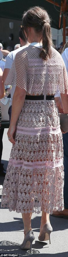 She showed off her trim figure in a £360 blush pink dress by Self Portrait...