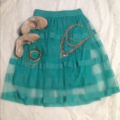 """Gorgeous Jade Green A-Line w/ Tulle Overskirt The most beautiful shade of jade green! Lined to about the knee. Sheer part goes a bit longer just below the knee. I'm 5'6"""" for reference. Size small. Waist laying flat measures 14"""" straight across. Elastic waistband. NWT. ❌NO TRADES ❌ NO PP❌NO LOWBALLING ❌ Boutique Dresses"""