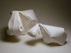 Dinh Truong Giang follows a more minimal approach, wet folding watercolor paper to create these lovely sculptures. The work has a quiet grace that is utterly appealing.