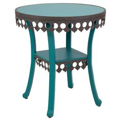 Showcasing a lace-inspired skirt and painted blue finish, this charming end table offers vintaged appeal for your living room or master suite.