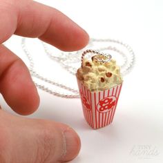 Scented Popcorn Necklace | Movie time just got a whole lot better! This scented popcorn necklace is a miniaturized replica of what you'd get at the theater. Complete with the buttery fragrance of real popcorn!