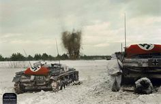 Sturmgeschütz III (StuG III) Ausf. E assault guns advance on Soviet positions while laying down high explosive fire support. Infantry advance closely behind using the StuGs as mobile cover. Somewhere on the Eastern Front, 1941~1942.  These StuGs are all draped with aerial recognition flags/drapes.