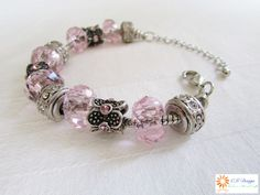 A beautiful and glamorous crystal like baby pink and deep silver snake chain bracelet.