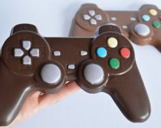 This solid chocolate Playstation video game controller is just downright cool! Wow your boys with them as they won't be able to believe they are made of chocolate! The controller is approximately Chocolate Playstation Controller Chocolate Videos, I Love Chocolate, Chocolate Gifts, How To Make Chocolate, Chocolate Lovers, Melting Chocolate, Cheap Chocolate, Chocolate Shapes, Video Game Cakes