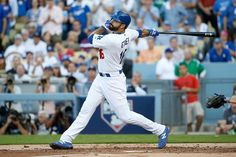 Andre Ethier #16 of the Los Angeles Dodgers hits a RBI single in the first inning against the New York Mets in game five of the National League Division Series at Dodger Stadium