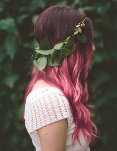 After dyeing your hair pink style is with curls + a flower crown.