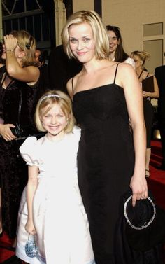 Dakota Fanning and Reese Witherspoon attend the 8th Annual Screen Actors Guild Awards at the Shrine Auditorium in Los Angeles CA (March 10, 2002)