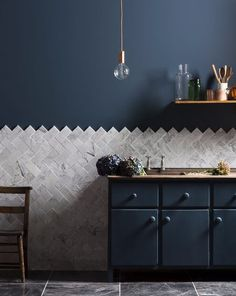 It's yet another way to do herringbone or hex tile, but with a little more character.