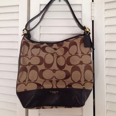 """Brown Coach Jacquard Signature Legacy Duffle Great condition ! This Brown Coach Jacquard Signature Legacy Duffle goes with any outfit. Zip top and outside zip pocket. Signature fabric with leather trim. Strap 18 3/4"""" drop for cross body wear converts to double strap for shoulder wear (as shown). Dust bag included. Coach Bags"""
