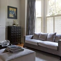 Cafe Style White Shutters In the Living Room Window Shutters Uk, Shutters With Curtains, Wooden Window Blinds, White Shutters, Wooden Shutters, Grey Curtains, Interior Doors For Sale, Interior Windows, Windows Decor