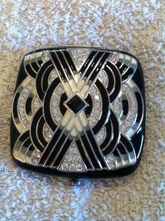 vintage black & white compact.  Unfortunately for me (who only likes vintage), Jay Strongwater is alive and making compacts for Estee Lauder.  But its beautiful!