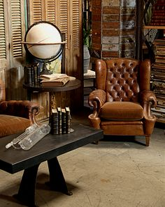 Tufted vintage and leather. All things we love in an armchair. http://bdantiques.com/