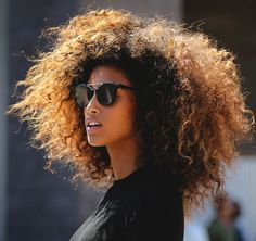 Imaan Hammam // gorgeous curly hair, edgy sunglasses & a black top #style #fashion #model #streetstyle