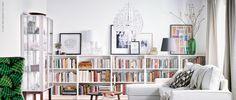 bookshelf with art