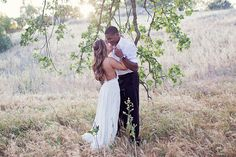 Love this romantic moment between the bride and groom captured by @laphotomama