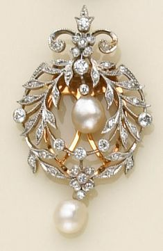 A diamond, pearl and platinum-topped gold clip-brooch