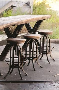 MIXfurniture.com  - Industrial Factory Stool with reclaimed wood gathering bar table. Love the raw wood with dark iron and wood distressed X legs.