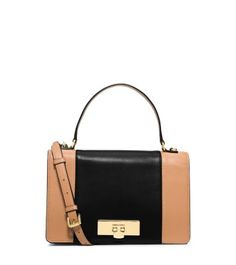 Ladylike goes luxe, care of our Callie handbag, featuring a graphic color-block design. Crafted from calf leather with a polished gold-tone clasp, this messenger's structured top handle adds a feminine flourish. Pair it with a cashmere knit and tailored trousers for day, or an LBD and strappy sandals at night, and you'll look the part of leading lady.