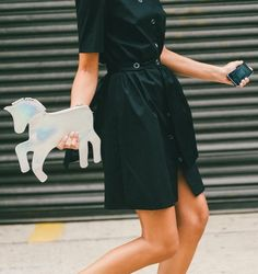 The cutest unicorn purse. Need. // More Street Style Inspiration from NYFW: (http://ny.racked.com/2014/9/11/7577343/nyfw-spring-2015-street-style-2#4395166)
