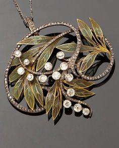 ART NOUVEAU PENDANT/BROOCH, CIRCA 1900. Composed of gold, plique-à-jour enamel and diamonds.