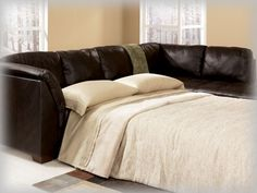 Chocolate Leather Sectional Sleeper Sofa $750       that's what I'm talking about!!
