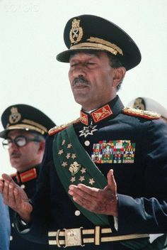 Anwar Sadat Praying | President Anwar Sadat of Egypt at a military review parade shortly before he was assassinated by soldiers in the parade.