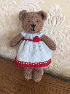 Say hello to this gorgeous bear! She is hand knitted using beautiful baby alpaca wool. Her pretty little dress is made from 100% cotton and is removable. Her shoes cannot be removed. She is made using all new materials and is stuffed with crest-a-Lon fibre filling. This bear is
