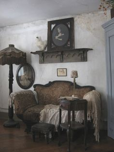 I like this parlor, but I can't see laying on this sofa reading a book. But I do love the feel of the room.