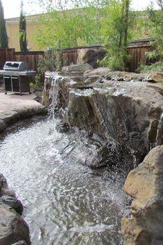 Stonemakers-backyard-waterfall.JPG