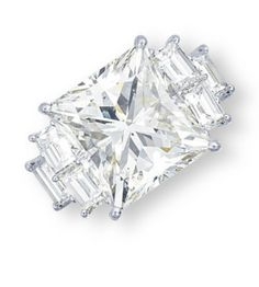 A DIAMOND RING  Set with a square-shaped diamond, to the baguette-cut diamond shoulders, mounted in platinum