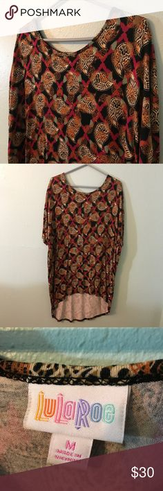 Lularoe Medium Irma Top Lularoe Medium Irma top. I wore this once and I'm selling items I no longer use or wear anymore. No defects or problems. Bundle and save! Or make an offer! Smoke free home. LuLaRoe Tops Tunics